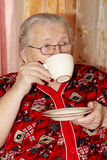 Old Woman And Tea Stock Photo