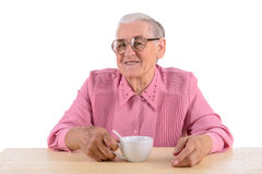Old woman andcup of tea Royalty Free Stock Photo