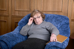 Old woman in an armchair Royalty Free Stock Photography