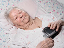 Old woman with arterial pressure measure Stock Photography