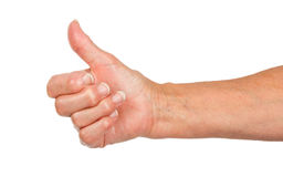 Old woman with arthritis giving the thumbs up sign Royalty Free Stock Images