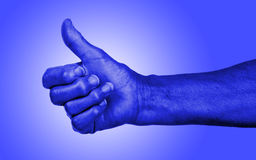 Old woman with arthritis giving the thumbs up sign Royalty Free Stock Photos