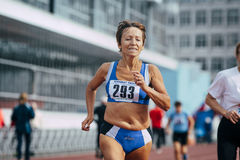 Old woman athlete running Royalty Free Stock Photos