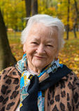 Old woman in autumn park Stock Images