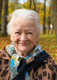 Old woman in autumn park Stock Photo