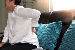 Old woman back pain at home, health problem concept stock photos