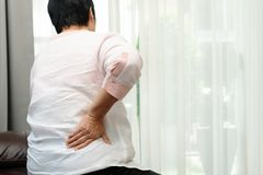 Old woman back pain at home, health problem concept stock photography