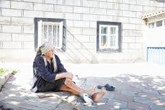Old woman at backyard Stock Photo