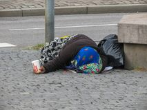 Old woman begging in Goteburg Stock Photo