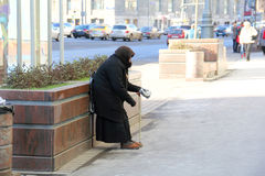 Old woman begging Royalty Free Stock Image