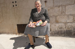 Old woman on bench Rab Croatia. An old woman sitting on a bench in Rab Croatia Stock Images