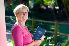 old woman & bible Royalty Free Stock Photo