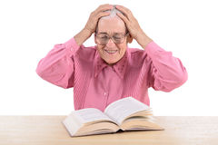 Old woman with book Stock Photography