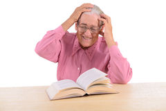 Old woman with book Stock Images