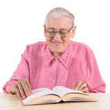 Old woman with book Royalty Free Stock Image