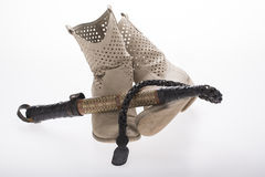 Old woman boots with whip Royalty Free Stock Photo