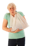 Old woman with broken wrist in gypsum Stock Images