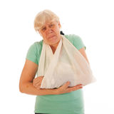 Old woman with broken wrist in gypsum and pain Stock Photos