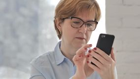 Old Woman Browsing Smartphone. 4k high quality stock video