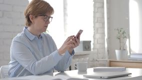 Old Woman Browsing Smartphone. 4k high quality stock footage