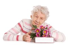 Old woman with bunch of flowers Royalty Free Stock Images