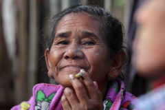 Old woman from Burma smoking a cigar Royalty Free Stock Photo