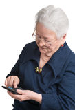 Old woman with calculator Stock Images
