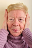 old woman can not hear at the moment Royalty Free Stock Photos