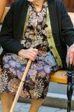 Old woman with a cane Stock Photo