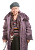 Old woman with a cane in outwear Royalty Free Stock Photography