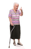 Old woman with a cane showing ok sign Royalty Free Stock Images