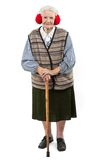 Old woman with a cane wearing faux fur ear muffs Royalty Free Stock Image