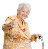 Old woman with a cane Royalty Free Stock Image