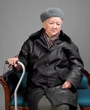 Old woman with a cane in winter outwear Stock Images