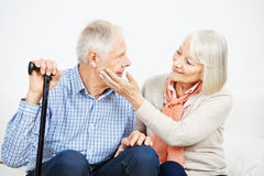 Old woman caressing check of senior man Stock Photography