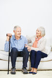 Old woman caring for senior man Stock Photos