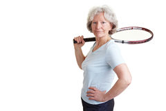 Old woman carrying tennis racket Stock Photos