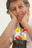 An old woman is celebrating her birthday royalty free stock photo