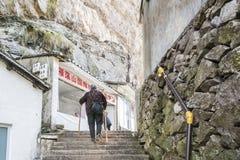 The old woman climbing mountain Stock Photos