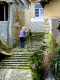 An old woman climbing the stairs Royalty Free Stock Photos