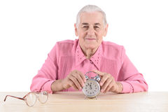Old woman with clock Stock Photos