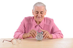 Old woman with clock Stock Photography