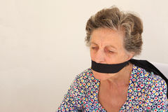 An old woman with closed mouth Stock Images