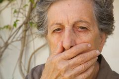 An old woman with a closed mouth Stock Photos