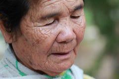 Old woman closes one's eyes. At thailand Royalty Free Stock Photos