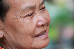 Old woman closes one's eyes. At thailand Royalty Free Stock Image