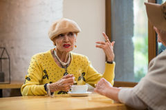 Old woman and coffee cup. Royalty Free Stock Images