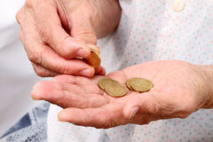 Old woman with coins Stock Image