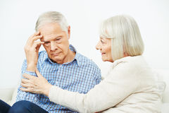 Old woman comforting senior man. Old women comforting senior men with depression at home Stock Photography
