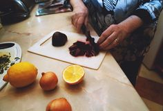 Old woman is cooking, cutting the beet. royalty free stock photos